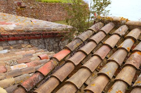 spanish village: Clay old roof tiles pattern in a spanish village Stock Photo
