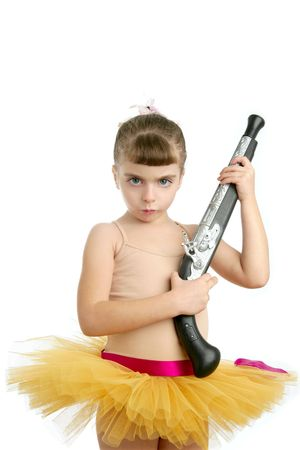 Beautiful little ballerina girl with blunderbuss weapon power and innocence photo