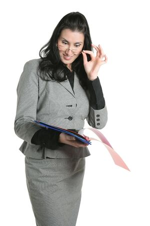 Businesswoman glasses teacher positive expression looking folders  photo