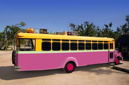 Colorful bus yellow and pink touristic tropical vehicle photo