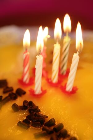 blowed: birthday cake candles light golden candlelight selective focus Stock Photo