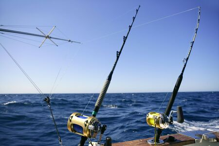 Angler boat big game fishing in saltwater ocean photo