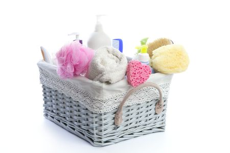 Bath toiletries basket with shower gel shampoo sponge and towel  photo