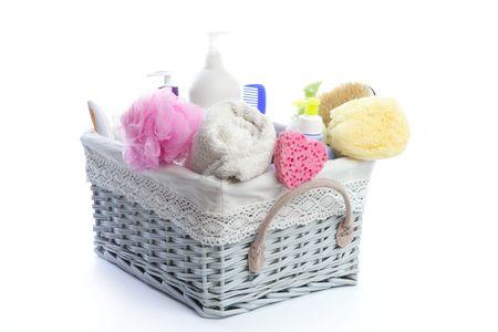 Bath toiletries basket with shower gel shampoo sponge and towel