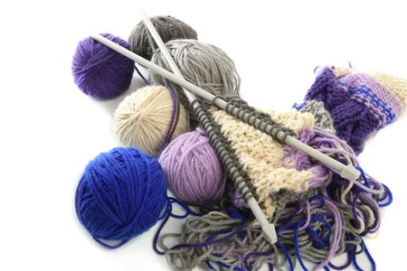 colorful knitting tools with wool thread balls photo