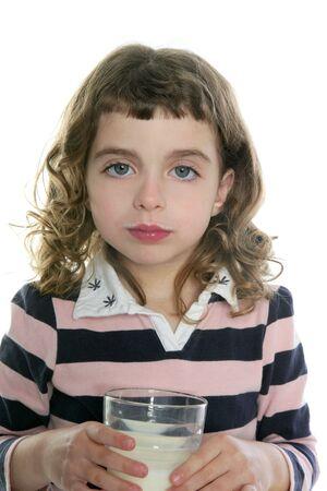 milk mustache: brunette little girl drinking glass of milk isolated on white Stock Photo