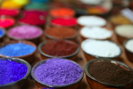 pigment: colorful powder pigments in rows in clay bowls