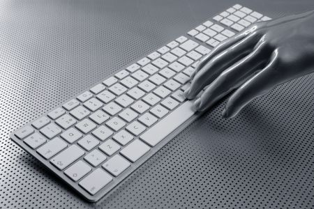 close button: computer keyboard aluminum gray hand silver background
