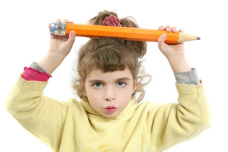 Little girl serious with big pencil in hand over white background    photo