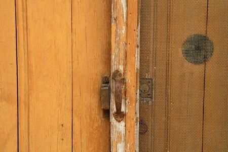 Background of aged grunge wooden door golden brown photo