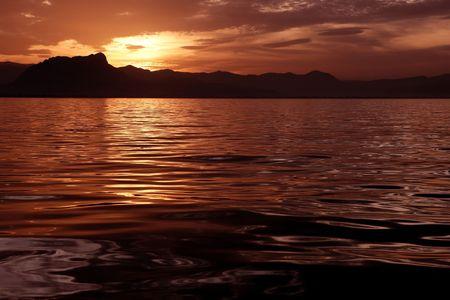 Beautiful seascape ocean sunset reflexion golden sea colors photo