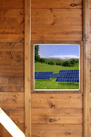 Solar plates meadow view from wooden window in a wood cabin Stock Photo - 6549167