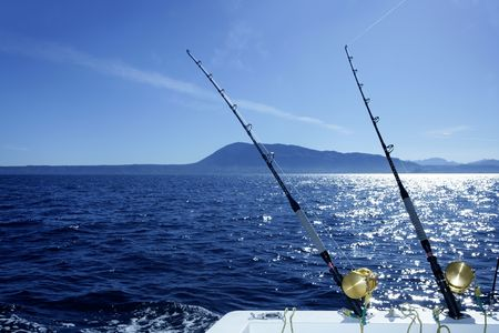 Blue Mediterranean trolling boat fishing saltwater with rods and reels photo