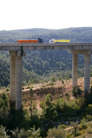 Far view of bridge with two lorries trucks  photo
