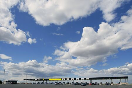 Toll motorway road in Europe in a sunny blue day with clouds photo