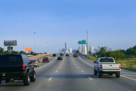 American road way to Houston city downtown with car traffic photo