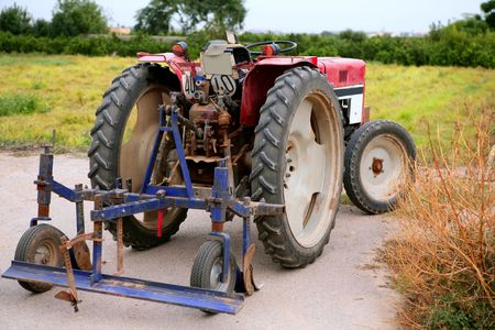 Agriculture aged red tractor  retro vintage machine Stock Photo - 6604546