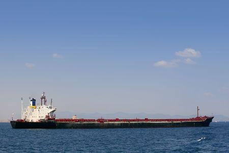 Oil tanker boat over blue Mediterranean sea  photo