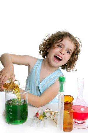 experiment: Beautiful chemistry little girl playing on a laboratory