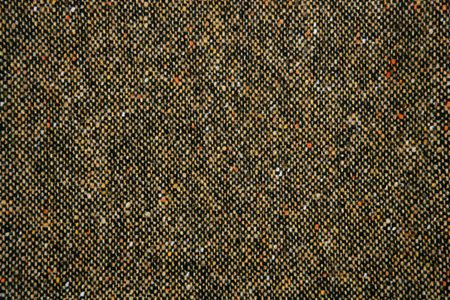 tweed: Cheviot tweed fabric background texture on brown color