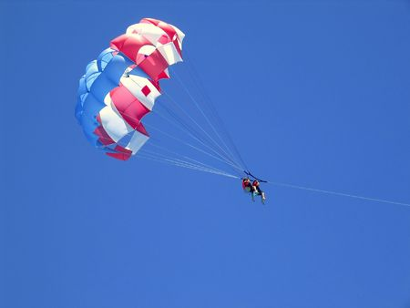 caribbean beach parachute vacation view from down over blue clean sky photo