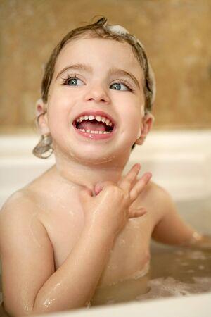baby little girl having bath on bathroom interior portrait photo