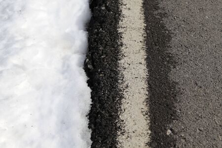 road white lines winter snow danger traffic photo