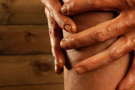 pottery craftmanship red clay potter hands work finger closeup Stock Photo - 6767531