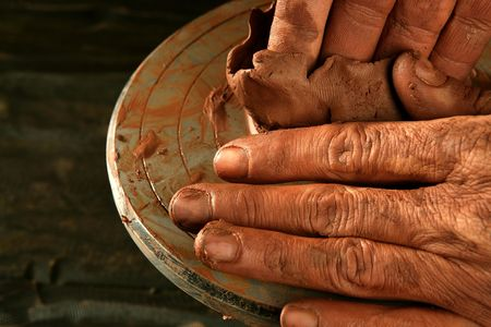 clay pot: pottery craftmanship red clay potter hands work finger closeup Stock Photo