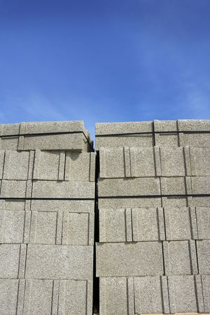 stacked construction block piles pattern photo