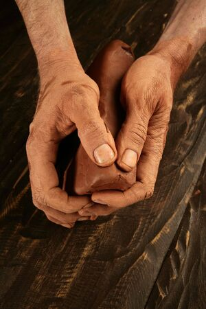 pottery craftmanship potter craftman hands working red clay photo