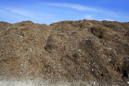 composting ecological compost  warehouse blue sky photo