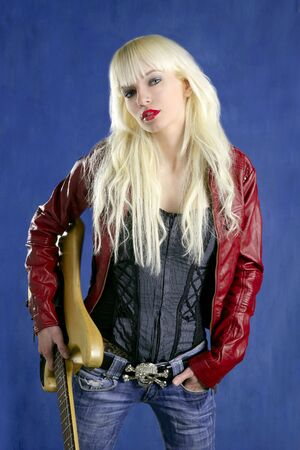 blond sexy fashion young girl electric guitar rock star blue background photo