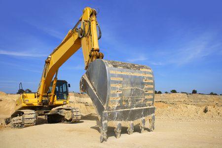 excavator yellow vehicle sand quarry outdoor blue sky Stock Photo - 6846596