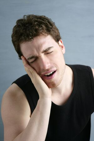 toothache headache pain gesture young man portrait photo