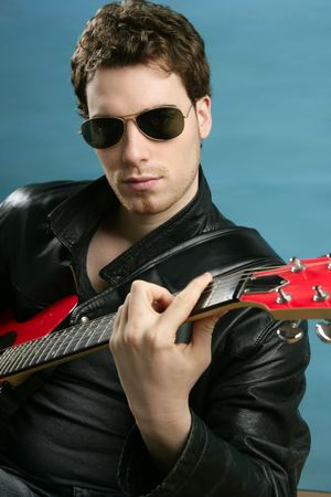 guitar rock star man sunglasses and leather perfect jacket over blue photo