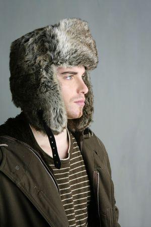 fur winter fashion hat young man brown autumn color photo