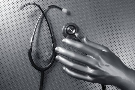 Health stethoscope futuristic silver gray hand concept metaphor     photo