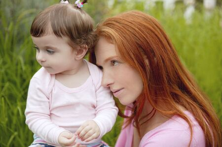 beautiful mother and baby little girl outdoor park garden grass playing photo