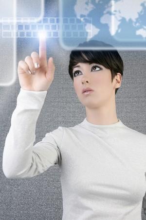 futuristic businesswoman finger touch pad keyboard digital light screen world map photo