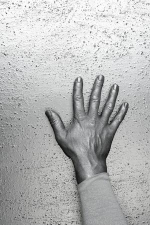 futuristic man: male futuristic man silver hand over textured steel background