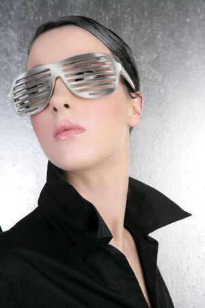 fashion woman futuristic steel glasses black shirt silver background photo