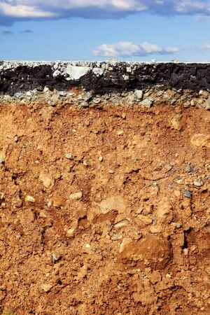broken asphalt road excavation earthquake cross section blue sky