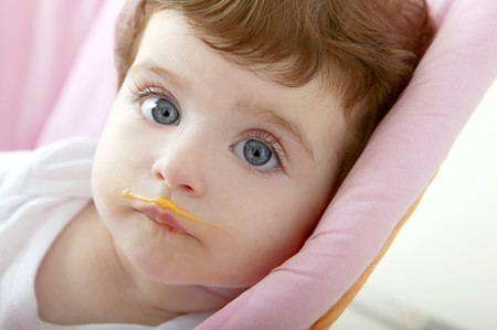 baby deity mouth of eating porridge orange color photo