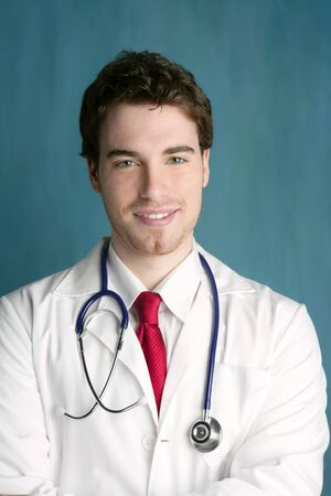 young male doctor: happy young male doctor man smile handsome portrait green background