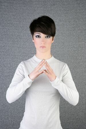 short: futuristic androgynous short hair brunette woman silver portrait