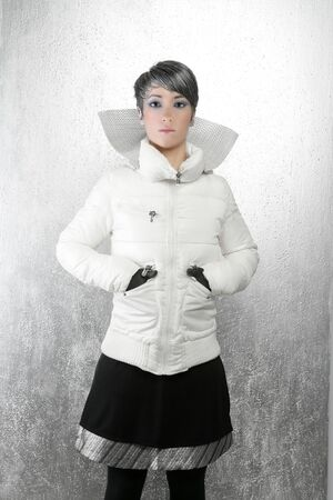 fashion futuristic winter woman look silver background photo