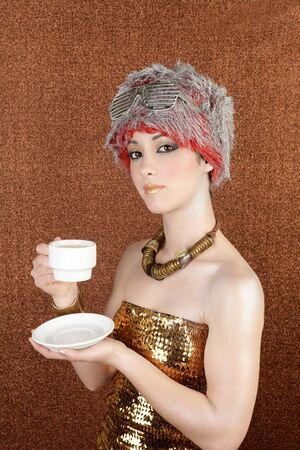 fashion futuristic silver gold cup of coffee on bronze background photo