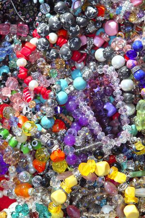 jewellery mixed colorful many jewels plastic jewelry background photo