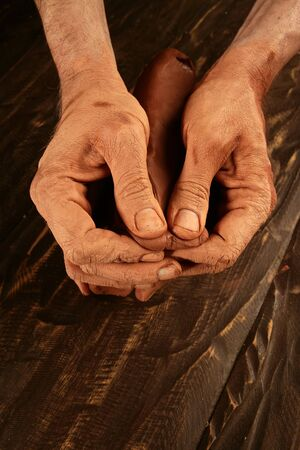 pottery craftmanship potter craftman hands working red clay Stock Photo - 6985612